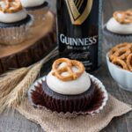 Chocolatey boozy cupcakes topped with a sweet cinnamony frosting and crunchy salty pretzels. Beer + cupcakes = tasty fun!