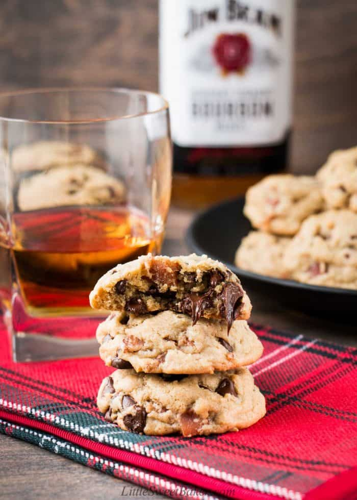 A stake of bourbon bacon chocolate chip cookies on a red napkin.