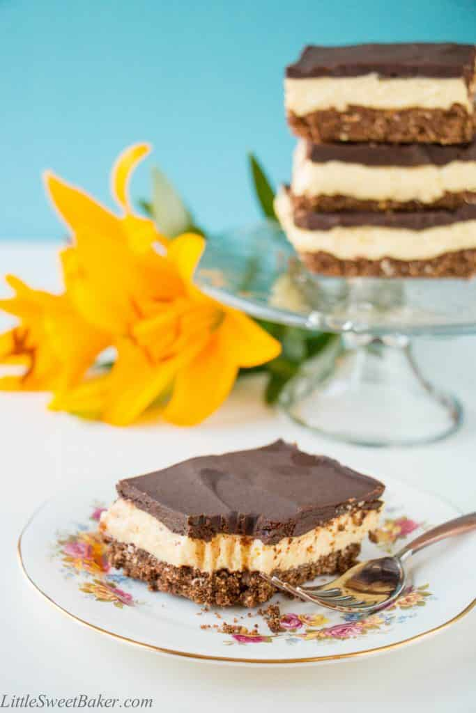 A creamy layer of vanilla custard flavored cheesecake sandwiched between a chocolatey coconut cookie crumb base and semi-sweet chocolate ganache. A twist to one of Canada's best known desserts. {Video Recipe}