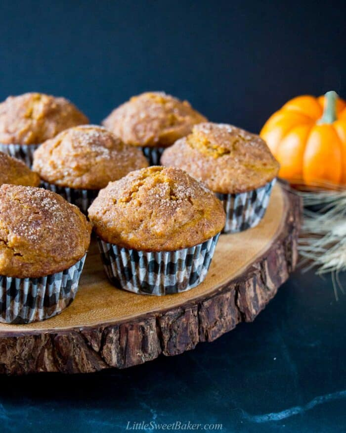 pumpkin muffins on a live edge wooden charger