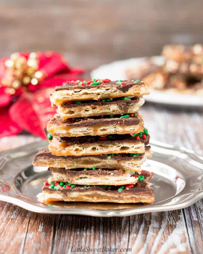 A stack of Christmas Crack on a silver plate.