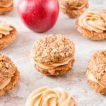 A creamy, sweet and salty peanut butter frosting sandwiched between two soft and chewy apple oatmeal cookies makes these whoopie pies absolutely irresistible.