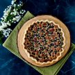 This recipe takes pecan pie and adds the intense flavor of bourbon and chocolate together in a sweet-gooey filling.