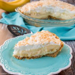 This amazing banana cream pie is made with a rich velvety-smooth homemade custard and it's lined with a honey graham cracker crust. Filled with delicious sweet slices of bananas and topped with fluffy whipped cream - it'a absolutely pie heaven! banana cream pie   best banana cream pie   easy banana cream pie   old-fashioned banana cream pie   homemade custard   coconut banana cream pie   graham cracker crust
