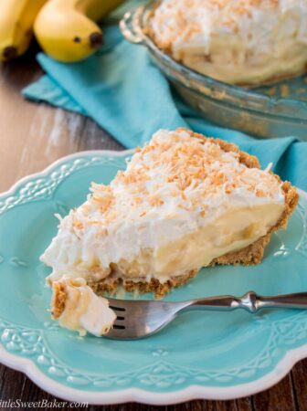 This amazing banana cream pie is made with a rich velvety-smooth homemade custard and it's lined with a honey graham cracker crust. Filled with delicious sweet slices of bananas and topped with fluffy whipped cream - it'a absolutely pie heaven! banana cream pie | best banana cream pie | easy banana cream pie | old-fashioned banana cream pie | homemade custard | coconut banana cream pie | graham cracker crust