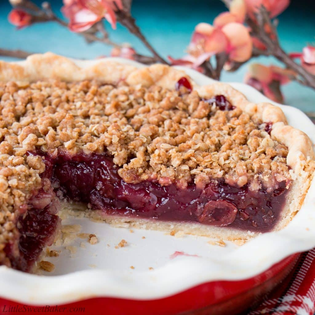 Enjoy this fabulous cherry pie all year round by using fresh, frozen or even jarred cherries with this easy and adaptable recipe. It's the best homemade cherry pie filling topped with a crunchy streusel topping and wrapped in a flaky pie crust. Cherry pie | sour cherry pie | best cherry pie | easy cherry pie | fresh cherry pie | cherry pie using frozen cherries