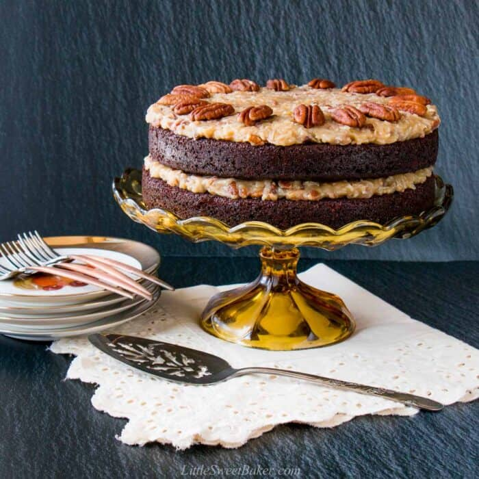 A German chocolate cake on a vintage cake stand.