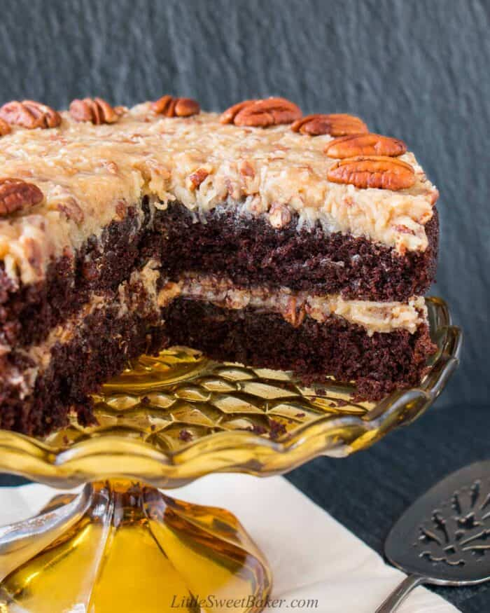 A German chocolate cake with a quarter of it cut out.
