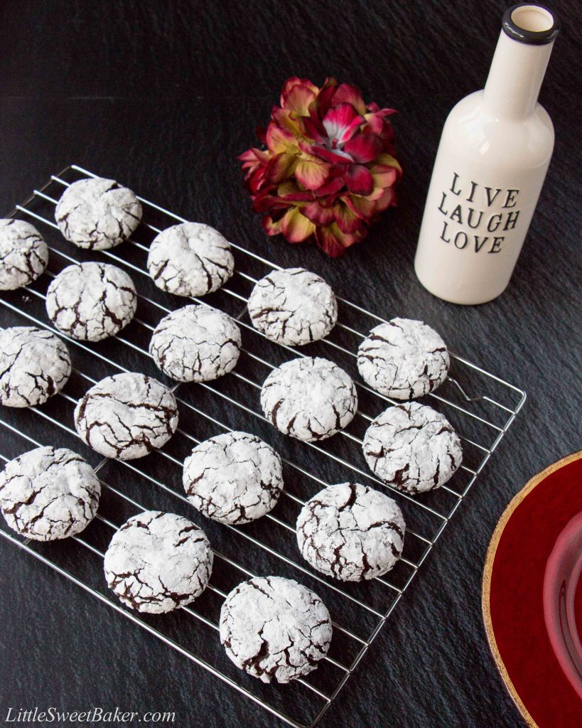 These fudgy chocolate crinkle cookies are rich and chewy like brownie bites rolled in powdered sugar. #chocolatecrinklecookies #browniecookies #Christmascookie #crinklecookies