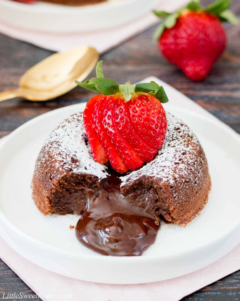 This rich and dense chocolate cake has an irresistible warm and gooey chocolate center that flows like lava when you break into the cake. Just a few simple ingredients and you can have this decadent dessert ready in under 30 minutes. #chocolatelavacake #chocolatemoltencake #moltenlavacake #valentinesdessert