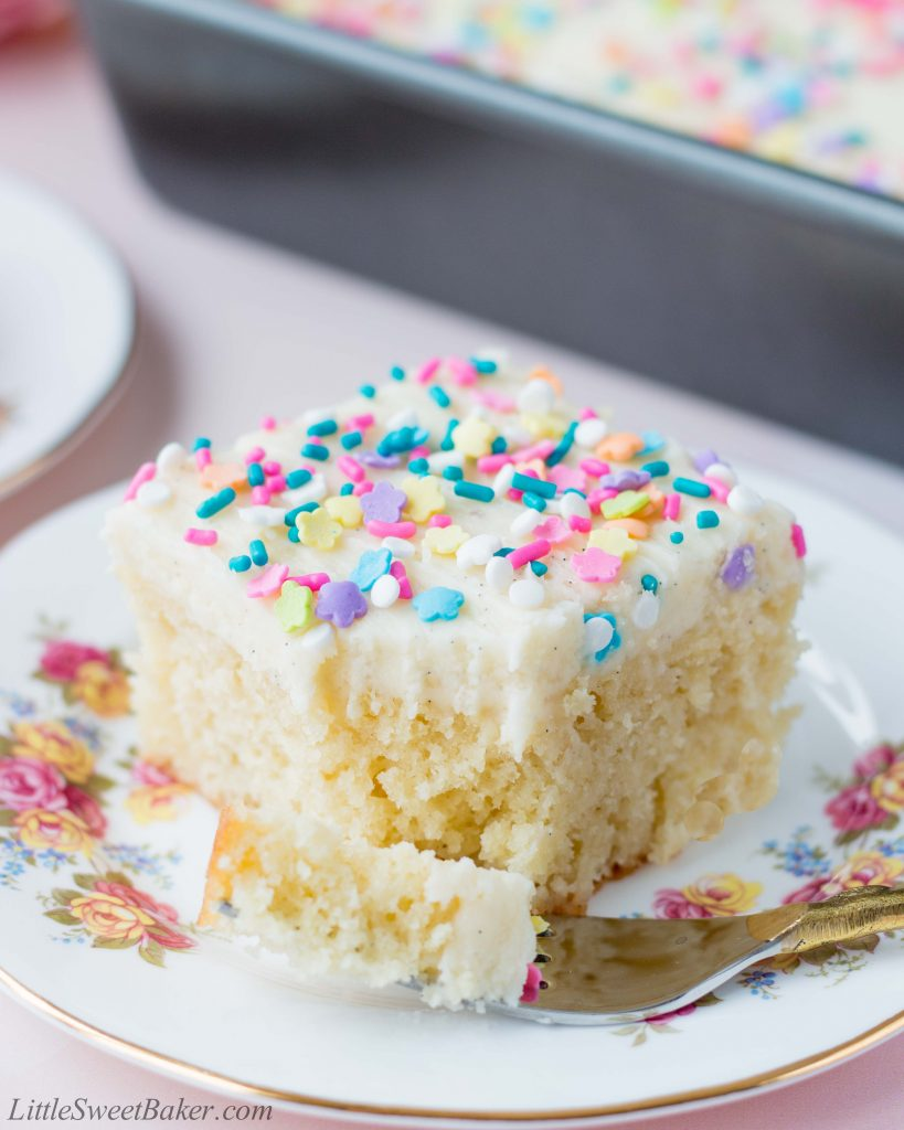 This delicious vanilla sheet cake is soft, moist and topped with a fluffy vanilla buttercream. It's the ultimate dream cake for vanilla lovers. #vanillacake #easyvanillacake #vanillafrosting #vanillabuttercream #vanillasheetcake