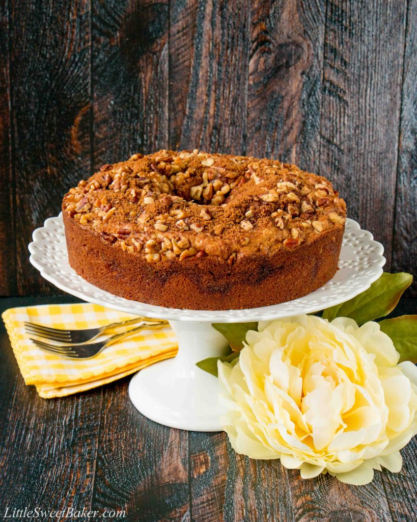 This soft, moist and tender coffee cake with its layers of cinnamon and brown sugar streusel is guaranteed to be your most requested dessert. #coffeecake #sourcreamcoffeecake #cinnamoncoffeecake #walnutcoffeecake