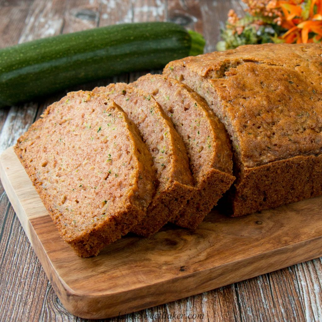 This basic zucchini bread is moist, flavorful and perfect as is or you can customize it to suit your taste by adding in your favorite mix-ins. #zucchinibread #easyzucchinibread #momszucchinibread