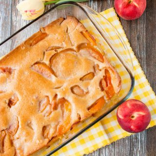 This heavenly peach cobbler consists of juicy flavorful peaches baked underneath a soft and fluffy cake topping. You can enjoy this made-from-scratch recipe all year round by using fresh, canned or even frozen peaches! #peachcobbler #easypeachcobbler #southernpeachcobbler