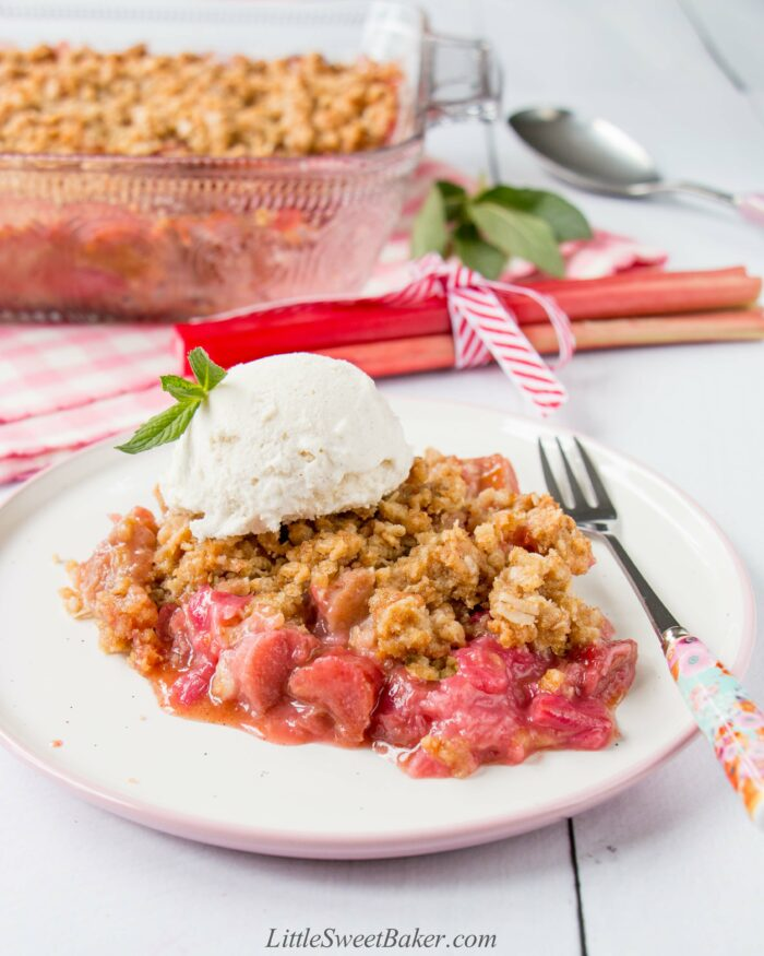 A plate of rhubarb crisp topped with ice cream.