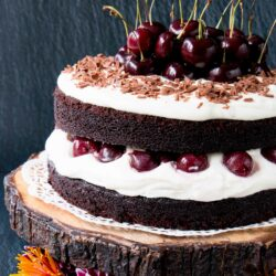 Easy Homemade Black Forest Cake - moist decadent chocolate cake surrounded by whipped cream and juicy black cherries. #blackforestcake #easyblackforestcake #blackforestgateau