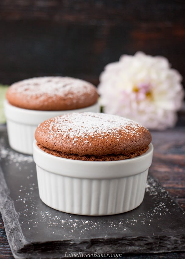 Two chocolate souffles on a piece of black slate.