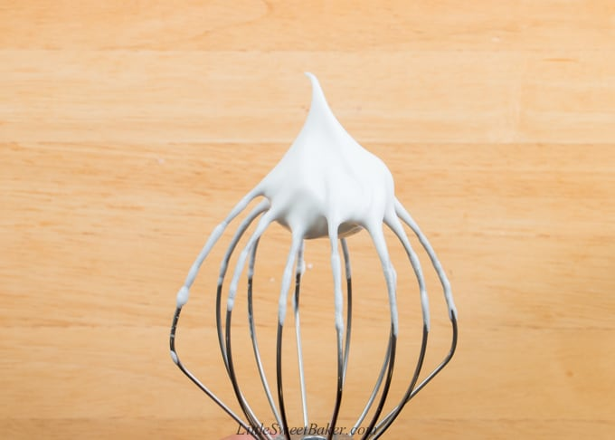 a whisk attachment showing egg whites beaten to stiff peaks