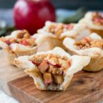 A cross between sweet and savory, these apple tartlets are wrapped in a flaky puff pastry and filled with apples, creamy brie and walnuts. #appletartlets #miniappletarts #appleandcheese #appetizer #snack