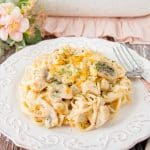 This turkey tetrazzini is creamy-cheesy good. It's filled with succulent chunks of turkey, silky mushrooms slices, onions, and spaghettini pasta baked in a creamy flavorful white sauce. #leftoverturkeyrecipe #turkeytetrazzini #turkeycasserole #pastacasserole