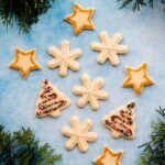 These soft baked sugar cookies are buttery, not too sweet, and taste amazing! They are just as fun and easy to make as they are to eat. #sugarcookies #cutout #recipe #Christmascookies