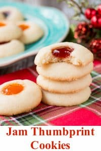 This classic holiday cookies is buttery and chewy with a delicious pocket of jam. #thumbprintcookies #Christmascookies #recipe #sugarcookie