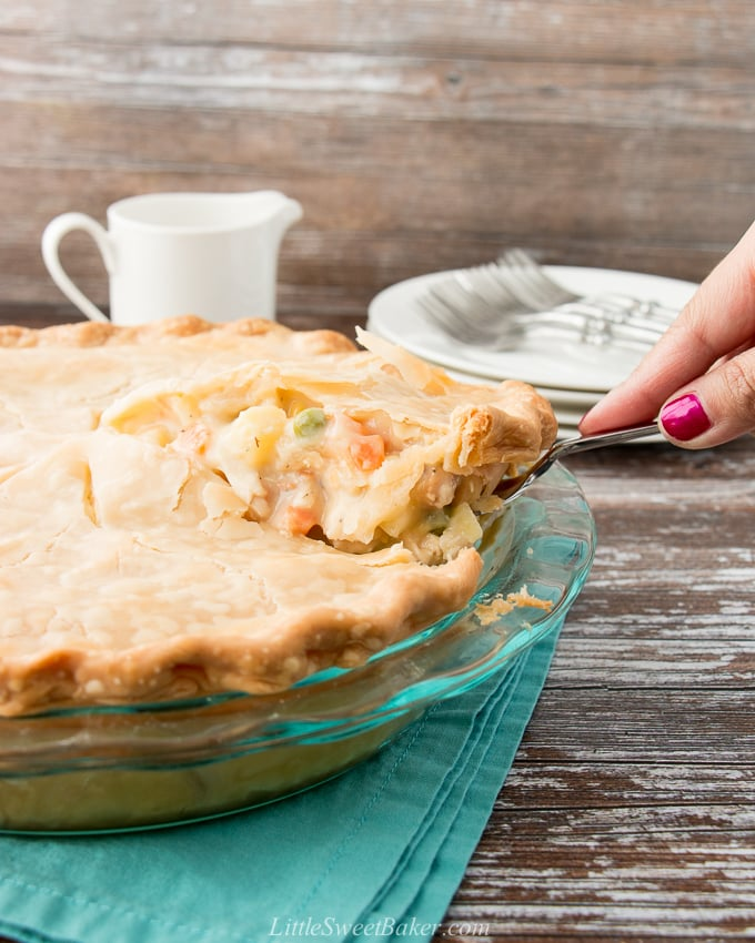 slice of chicken pot pie being lifted from whole pie