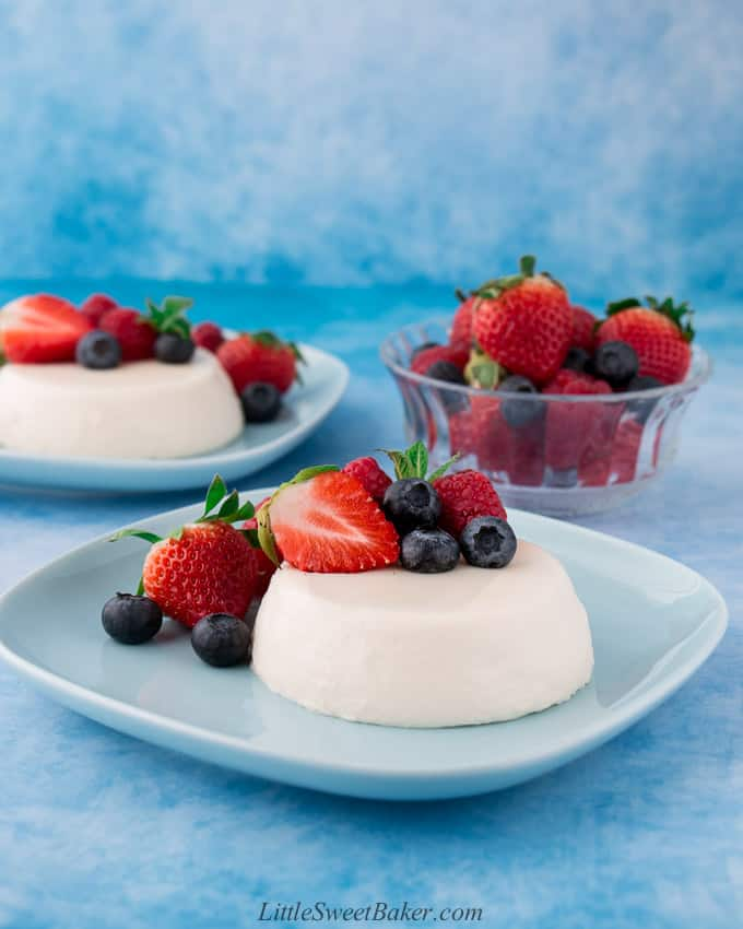 panna cotta with berries on a blue plate