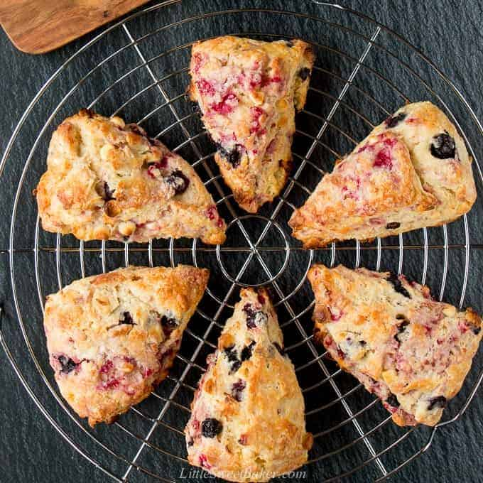 Half a dozen scones on a round cooling rack.