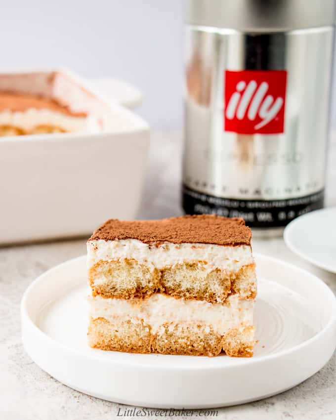 A slice of eggless tiramisu on a white plate.
