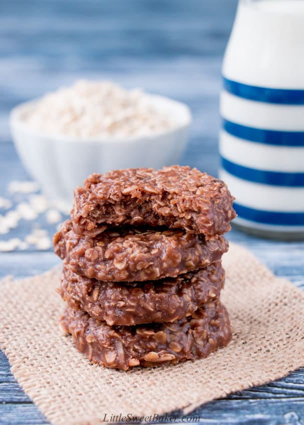 A stack of no-bake cookies with a bite taken out of the top one.