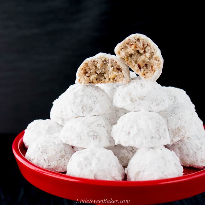 snowball cookies on a red plate