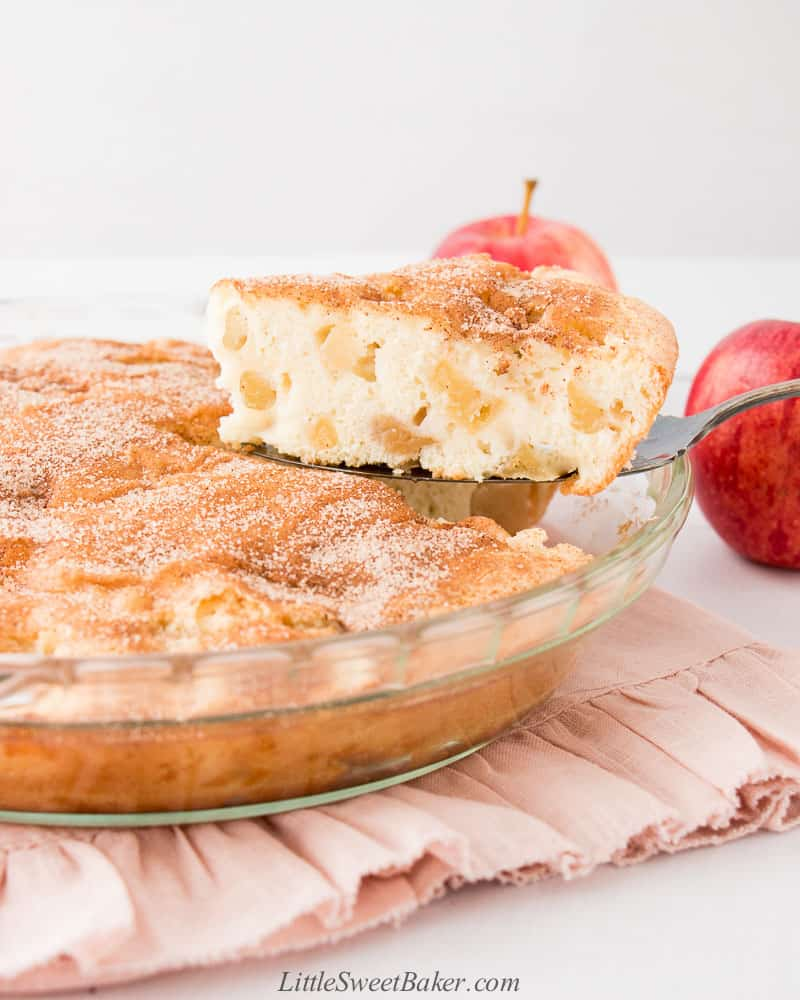 An apple cinnamon cake with a slice bring removed from it.