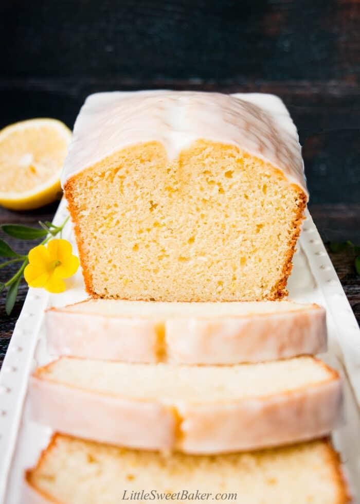 Lemon pound cake with lemon glaze on a white serving plate.