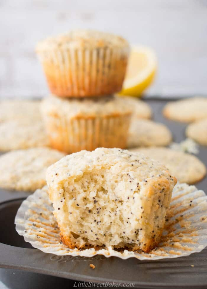 A lemon poppy seed muffin with a big bite taken out of it.