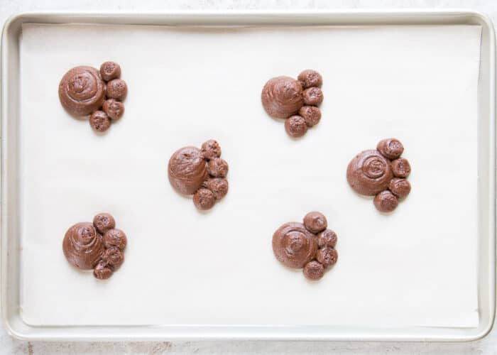 homemade bear paw cookies on a baking sheet ready for the oven