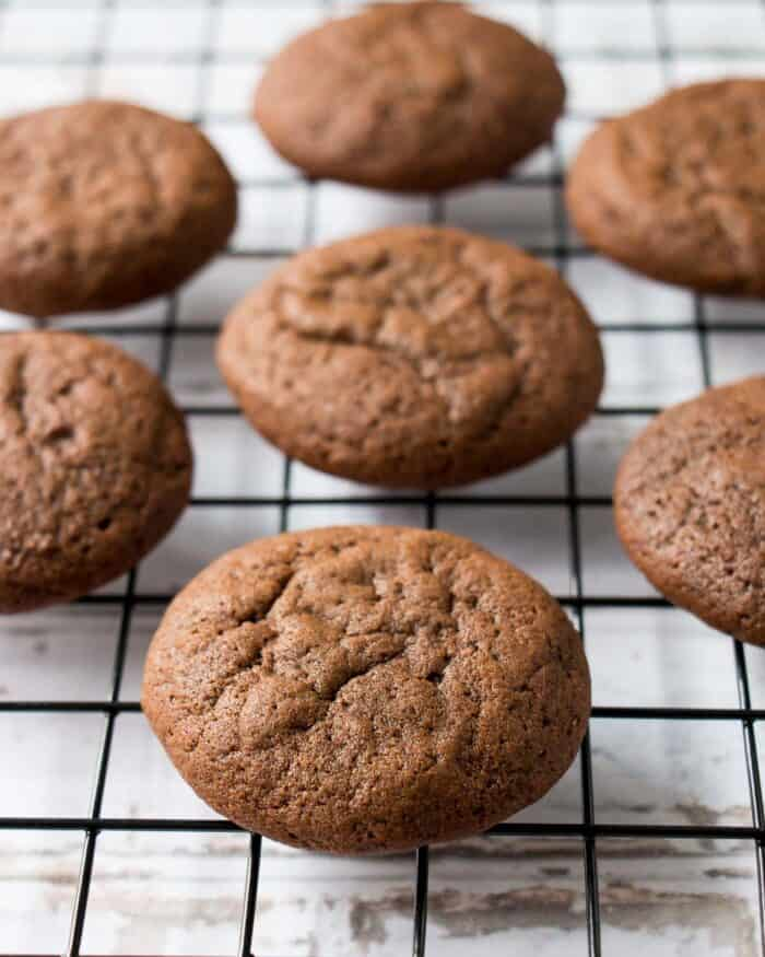 soft chocolate molasses cookies on a cooling rack