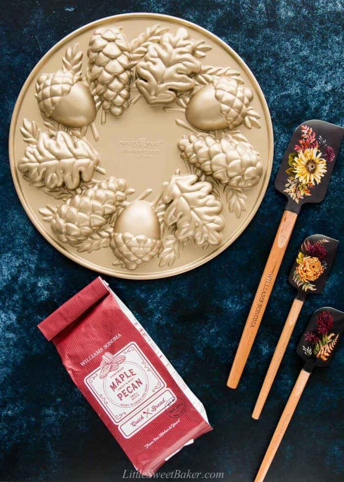 Nordic Ware Woodland Cakelet Pan and Williams Sonoma Maple Pecan quick bread mix and flower spatulas.