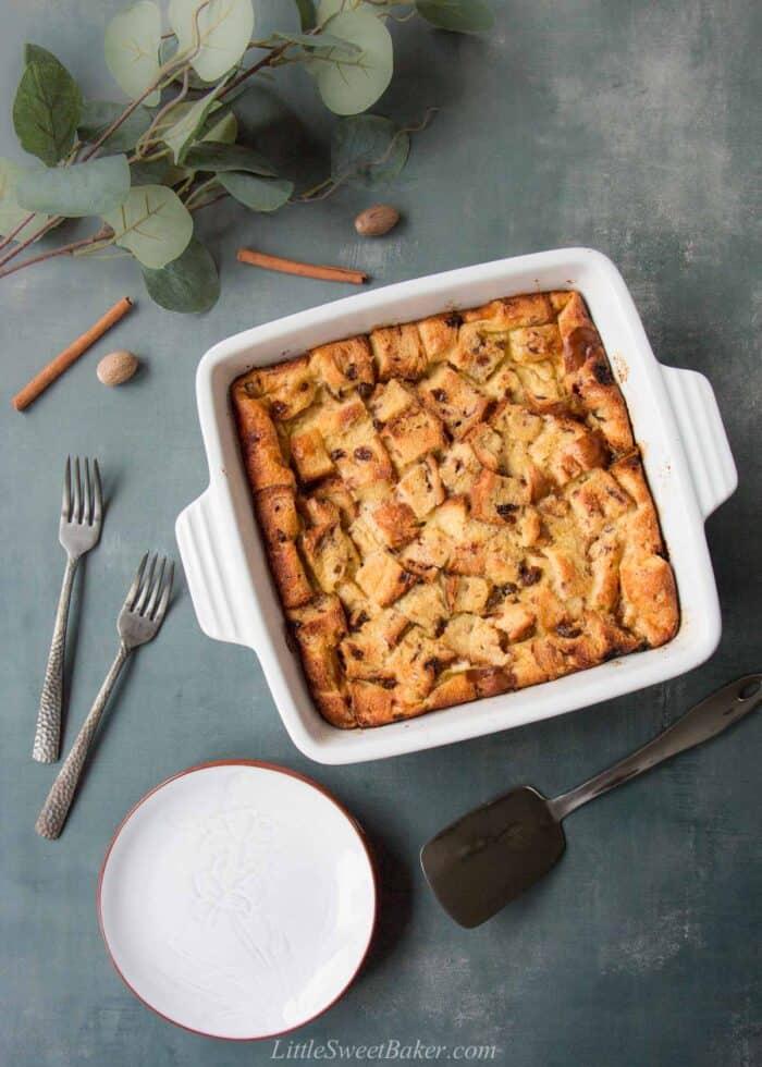 A square casserole dish of eggnog bread pudding.