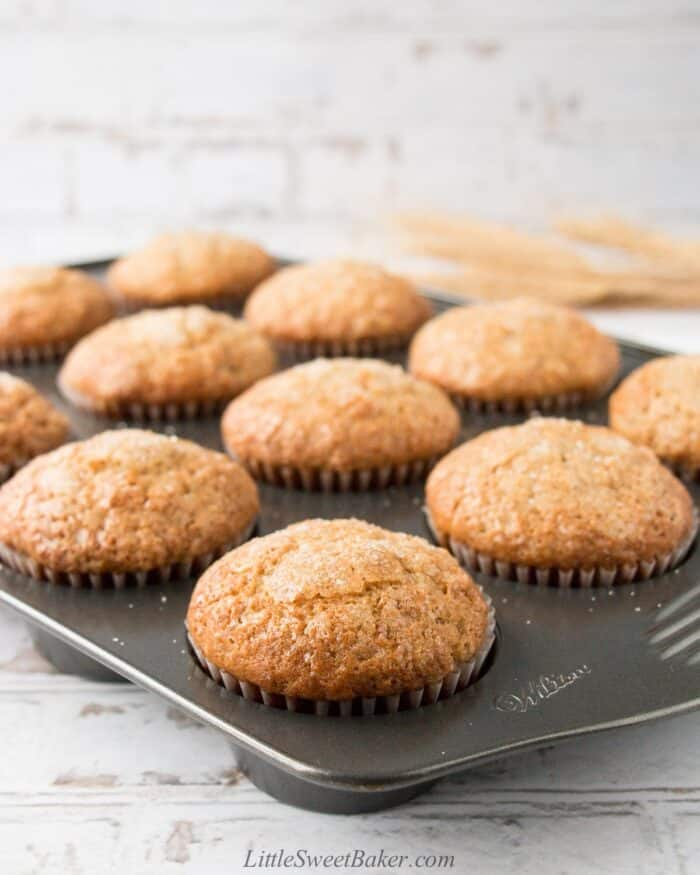 Moist and fluffy banana muffins in a muffin pan.