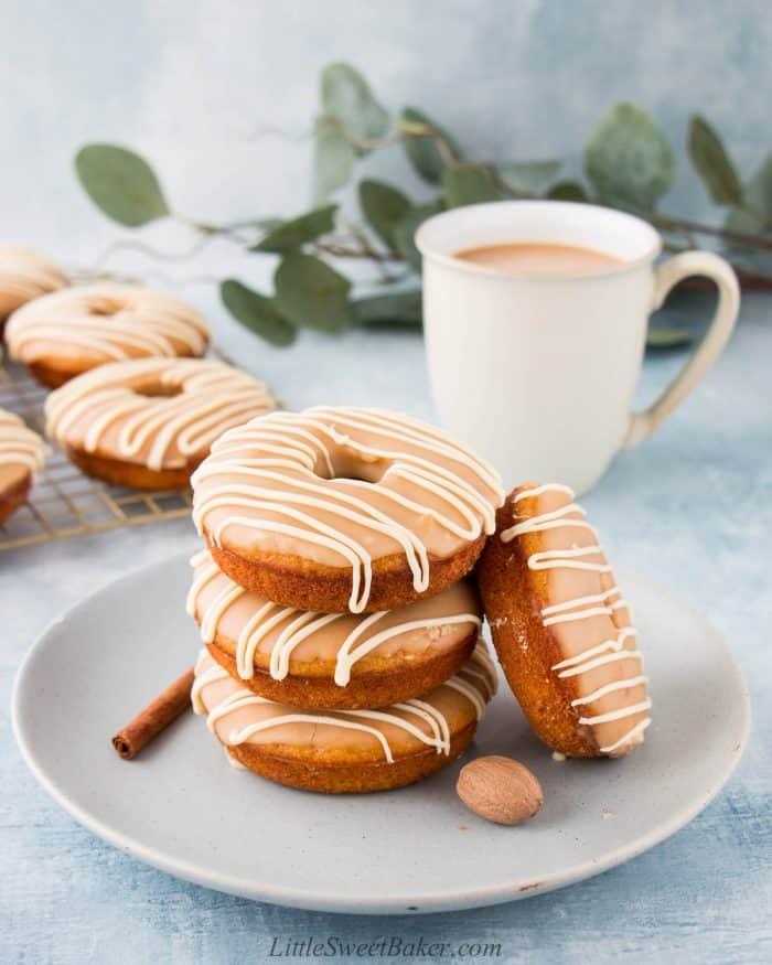 Four sweet potato donuts on a light blue plate.