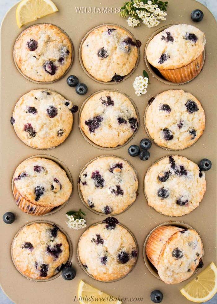 A golden baking pan of lemon blueberry muffins.