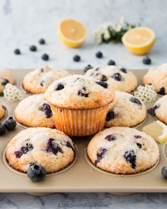 Blueberry lemon muffins in a golden baking pan.