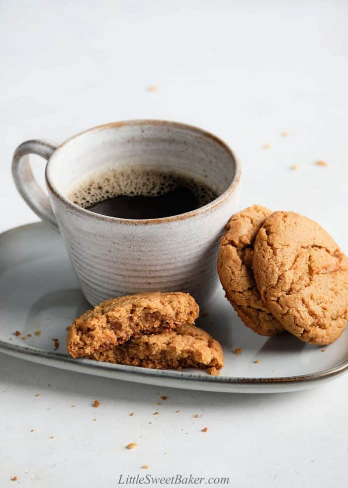 Healthy peanut butter cookies on a plate with a cup of coffee.