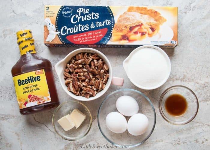 Ingredients to make easy pecan pie using store=bought pie crust.